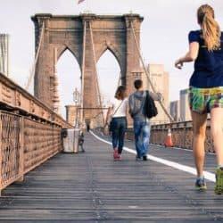 2 people jogging on a bridge
