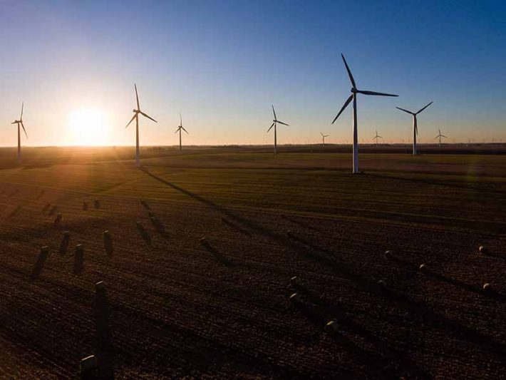 Renewable Energy from Wind Turbines at Sunset