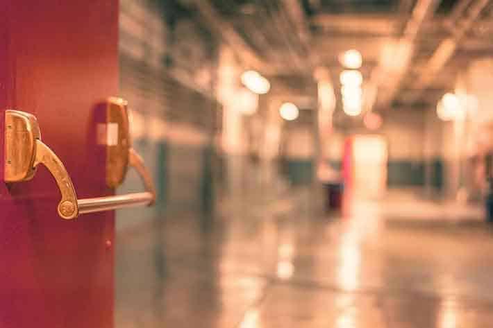 Save Electricity at School - Door Leading Into a Corridor